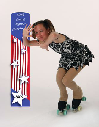 Picture of girl skater posing by banner
